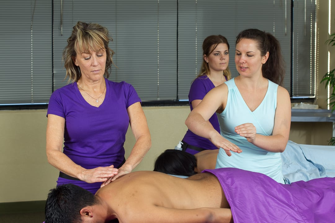Healing Hands Teaching student how to give massage